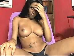 Hot looking busty ebony tranny dances and undresses for camera. She plays her eager cock.