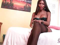 Hot black t-girl is skillfully teasing you through the camera.